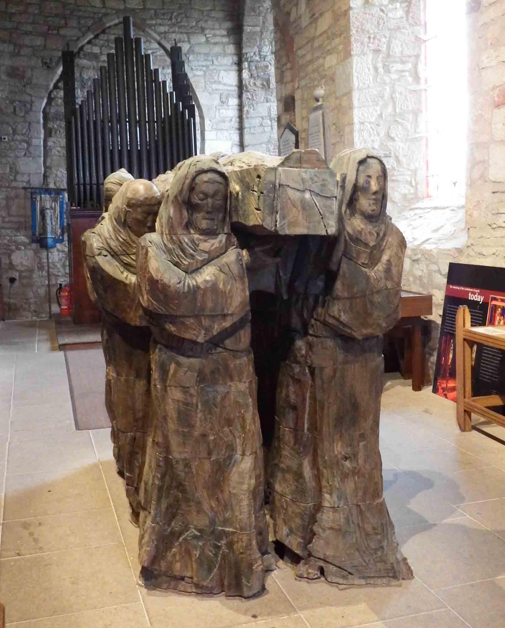 Carving of monks carrying 'Cuddy's corse'